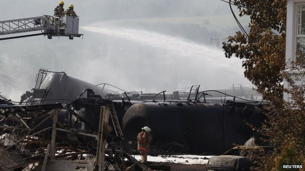 Firefighters work at the scene of the train derailment in Lac-Megantic, Canada, 7 July 2013