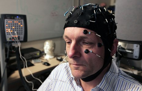 Michael Mosley with an electroencephalograph cap on to measure his brain's electrical activity