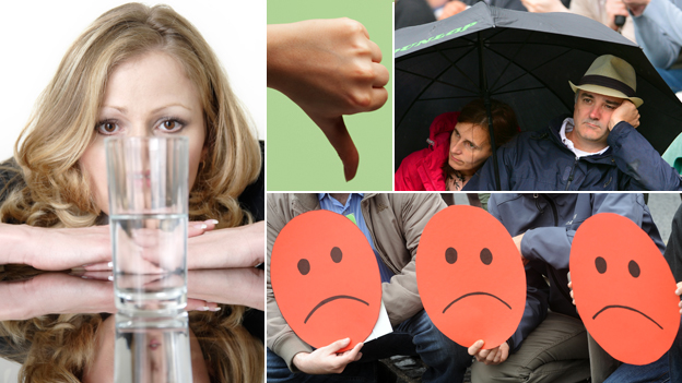 """A composite including: a woman looking at a half fully or half empty glass; a thumb pointing down; two people under an umbrella looking glum; and three unhappy """"smiley"""" faces"""