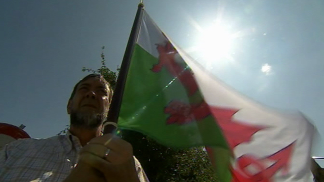 One of the Welsh memorial supporters with a Welsh flag in Flanders, Belgium