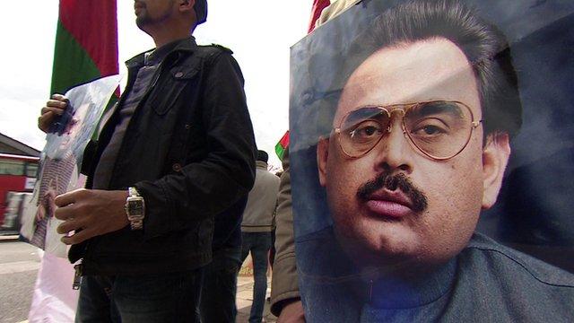 Man holding Altaf Hussain poster