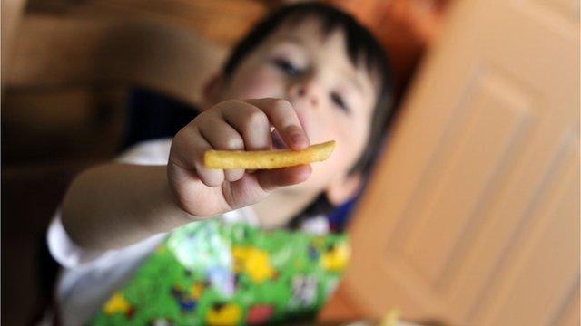 Boy eats chip