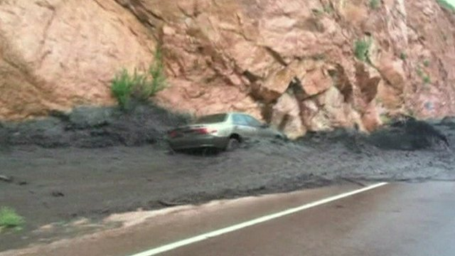 The car is swept away by the mudslide