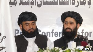 Muhammad Naeem (right), a spokesman for the Office of the Taliban of Afghanistan speaks during the opening of the Taliban Afghanistan Political Office in Doha on 18 June 2013