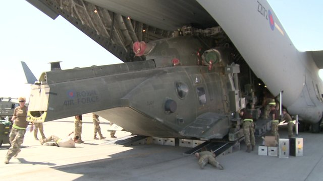 Merlin helicopter being loaded into back of am RAF C17