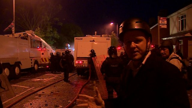 Chris Buckler with riot police