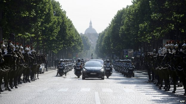"French President Francois Hollande arrives by car on the Place de l""Etoile on 14 July 2013 for the Bastille Day, the French National Day, parade in Paris"