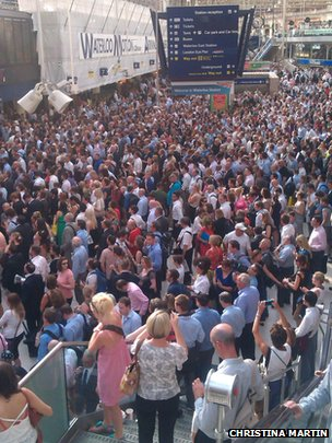 Crowds of commuters waiting at Waterloo station