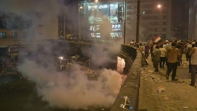 smoke fills the streets during clashes