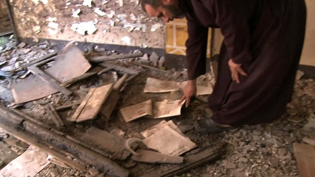 Father Ayoub Youssef in the looted church in the village of Dalga, Egypt