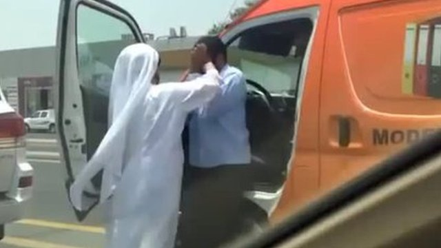 Screenshot of YouTube video showing man attacking a van driver with his agal - the rope used to keep the traditional Arab head dress in place.