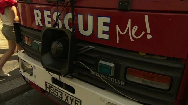Fire engine with Rescue Me written on it