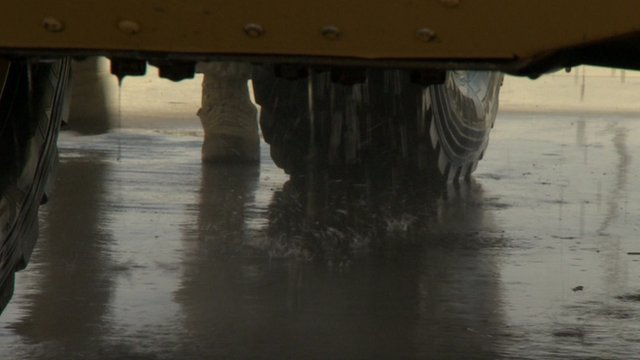 Underneath an armoured vehicle being washed in Afghanistan