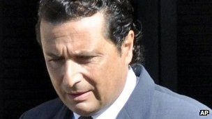 Capt Schettino leaving home for court, 14 May 2013