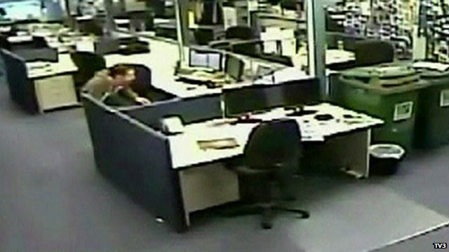 An employee takes cover in a New Zealand office