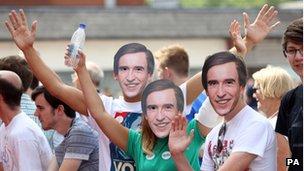 Fans in Partridge masks