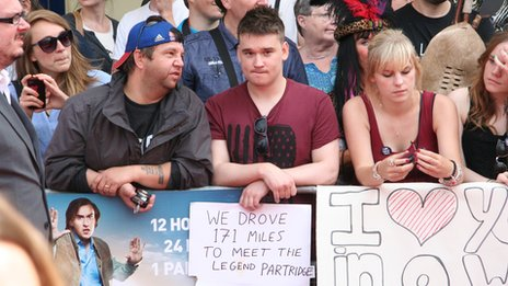 Fans with sign