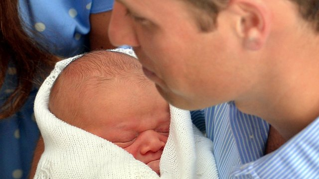 Prince William holding Prince George of Cambridge