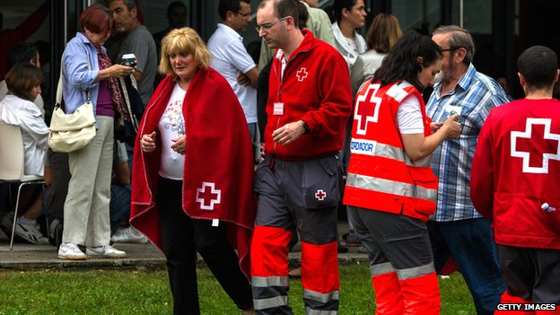 Relatives of passengers involved in the train crash wait for news at the Cersia Building in Santiago de Compostela