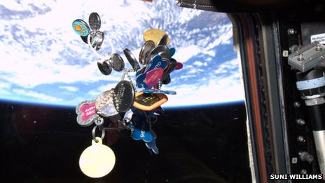 Dog tags float in the ISS