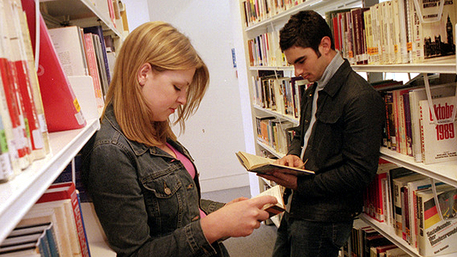 Students reading textbooks