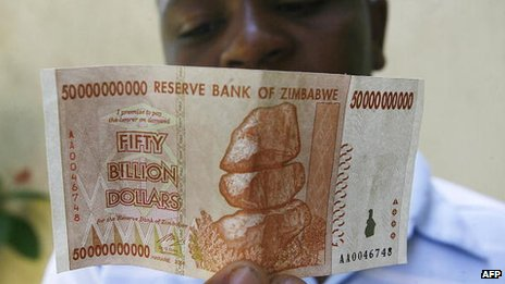 A Zimbabwean looks at a Z$50bn note issued by Zimbabwe's central bank on 13 January 2009