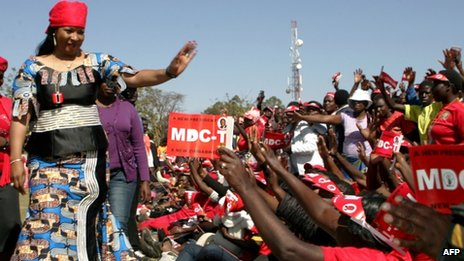 Elizabeth Tsvangirai, the wife of the presidential candidate of the Movement for Democratic Change (MDC) Morgan Tsvangirai, greets party supporters during an election campaign rally at Mkoba Stadium on 21 July 2013 in Gweru, Zimbabwe