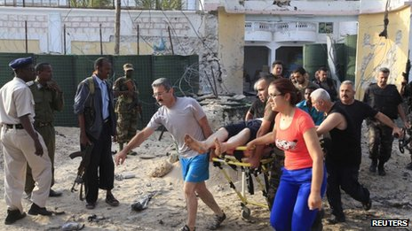 Turkish embassy staff carry a wounded person after a car bomb attack in Somalia's capital Mogadishu, on 27 July, 2013