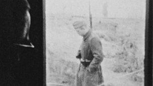 Prisoner watching German guard