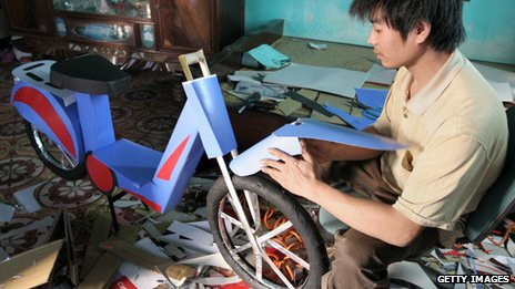 A paper model being constructed