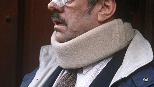 A man in a neck brace