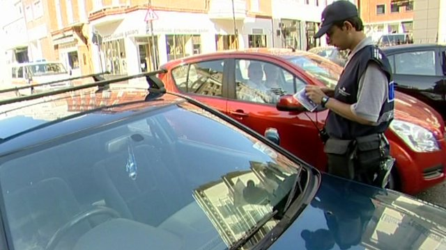 Traffic warden issuing a parking ticket