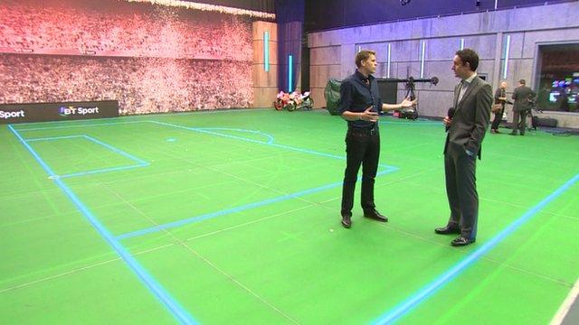 Jake Humphrey shows David Bond around the news tudio for BT Sport