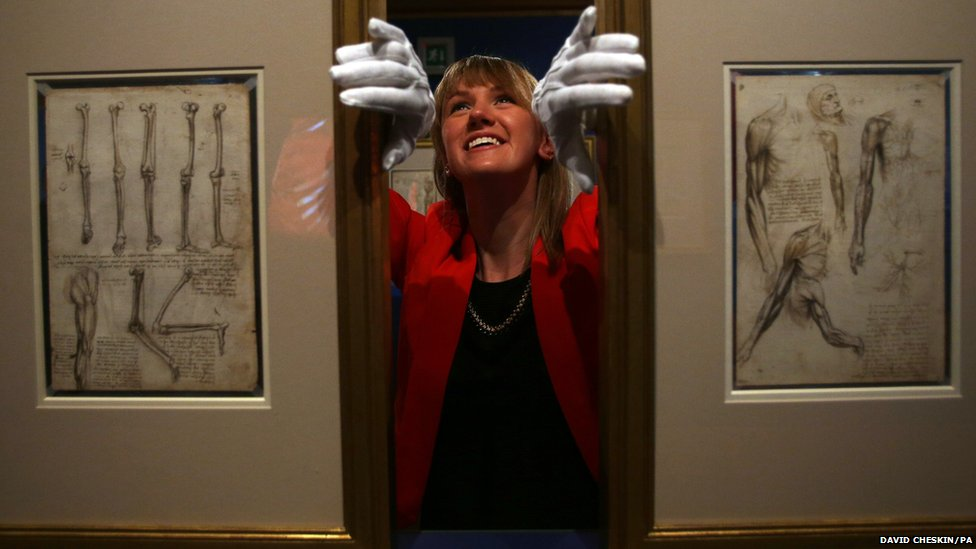 Staff member Sophie Lawrenson looks at some of the works on display as part of the new Leonardo da Vinci exhibition