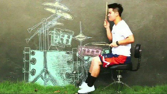 A Thai musician air drumming