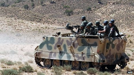 A picture taken on June 11, 2013 shows Tunisian soldiers patrolling in the Mount Chaambi region where the Tunisian army has been tracking militants the government says are veterans of the Islamist rebellion in northern Mali with links to Al-Qaeda in the Islamic Maghreb.
