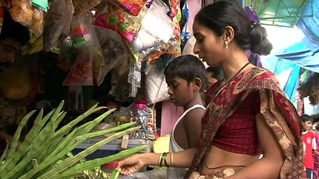 Woman buys vegetabales