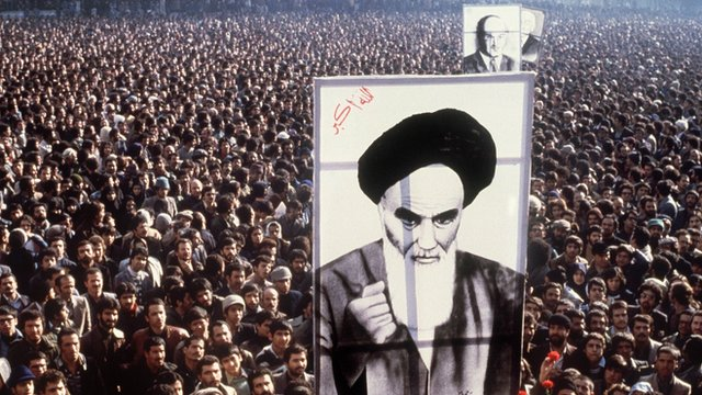 Iranian protesters hold a up a poster of Ayatollah Ruhollah Khomeini during a demonstration in Tehran