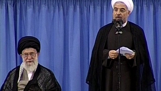 Hassan Rouhani (right)