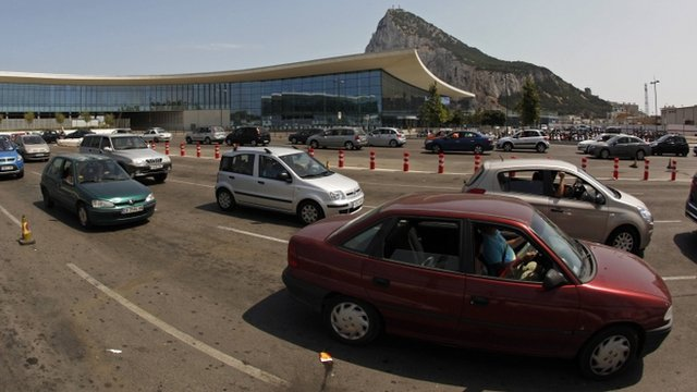 Vehicles wait in line to enter to Spain from Gibraltar