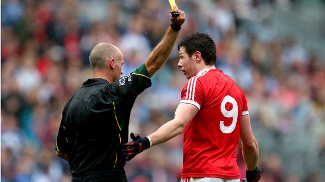 Sean Cavanagh is booked for a tackle on Conor McManus in the All Ireland quarter-final