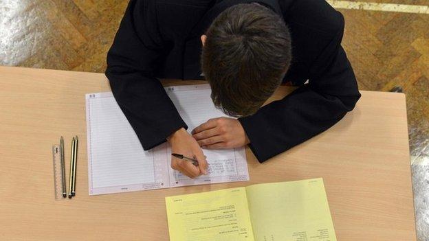 Boy doing exam paper