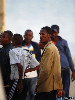Migrants freshly arrived in at Delimara, Malta, 4 August