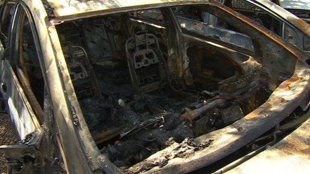 A burnt out taxi at the compound in Havant