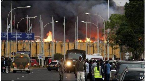 Black smoke billows from the international arrival unit of Jomo Kenyatta International Airport in Nairobi, Kenya on Wednesday morning