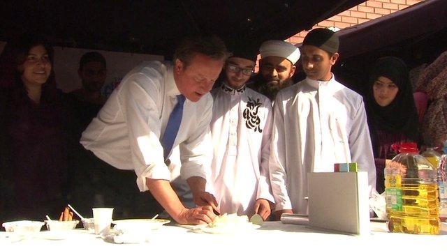 David Cameron chops onions at a mosque