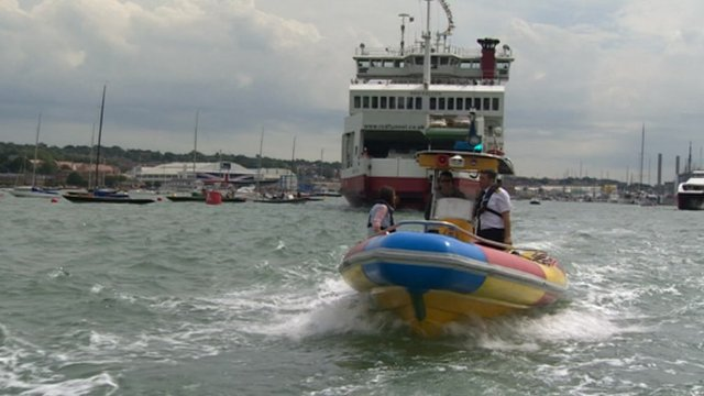Harbour master escorting a ferry at Cowes