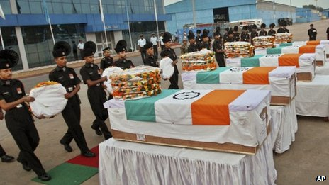 Indian soldiers pay tribute to their colleagues at a wreath laying ceremony at the Palam Technical Airport in Delhi, on August 7, 2013