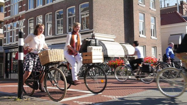 Women at Dutch bicycle traffic lights