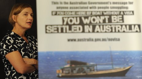 Australia's Acting High Commissioner to Sri Lanka Sonya Koppe looks on behind a banner on new measures to curb Sri Lankans illegally entering Australia at a press conference in Colombo on 26 July 2013